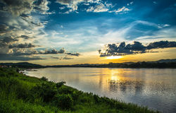 Sunset river beautiful evening. Beautiful Sunset Landscape with reflection on River Sky and Clouds Stock Photos