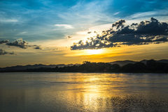 Sunset river beautiful evening. Beautiful Sunset Landscape with reflection on River Sky and Clouds Royalty Free Stock Photography