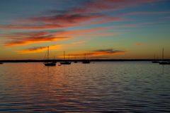 Sunset on the river. Boats on the river during sunset stock photos