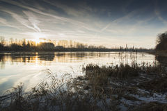 Sunset at river with cattails Royalty Free Stock Photo