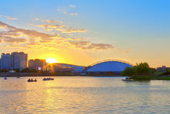 Sunset on the river in the city Stock Images