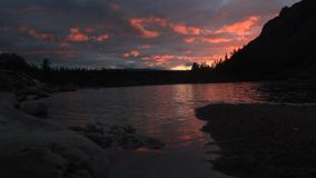 Sunset on the river stock video
