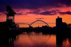 Sunset River Clyde Glasgow Scotland. Sunset over the Clyde river Glasgow Scotland United Kingdom Dec-15-08 showing Finnieston crane and squinty bridge Royalty Free Stock Photography
