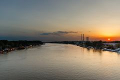 Sunset on the river Sava and industrial zone of Belgrade stock photos