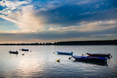 Sunset on river Danube with few boats royalty free stock photography