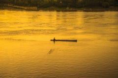 Sunset river fishing boat Stock Photo