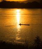 Sunset river fishing boat Stock Image