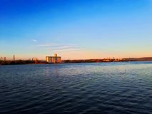 Sunset on river. The Kladovo port on Danube river in sunset,East Serbia in September Royalty Free Stock Photos