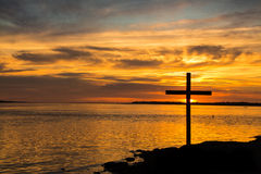 Sunset River Mouth. Sunset over a river month with a cross Stock Images