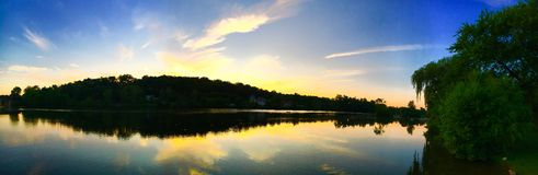Sunset River Panorama. A panorama of the sun setting over a beautiful river Stock Image