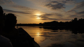Sunset on River at rain forest in Amazonas, Brazil Stock Photo