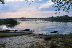 Sunset on the river, sports boats Royalty Free Stock Photos