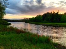 Sunset River. Springtime peach and yellow sunset over Maine river Stock Image