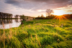 Sunset, river and sun rays. In Gorzow Wielkopolski, Poland. Landscape photography Royalty Free Stock Image