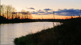 Sunset on the river Stock Images