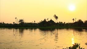 Sunset at river, time lapse stock footage