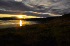 Sunset on the river in tundra. Royalty Free Stock Photos