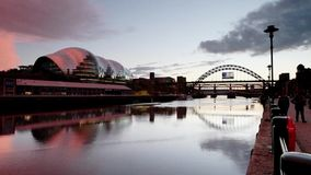 Sunset on the River Tyne. A timelapse recording of a sunset on the River Tyne.  The recording shows music venue the Sage in  Gateshead and the Tyne Bridge stock video footage