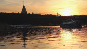 Sunset on the river in urban landscape. With river ship stock footage