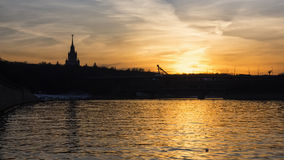 Sunset on the river in urban landscape Royalty Free Stock Photography