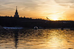 Sunset on the river in urban landscape Royalty Free Stock Images