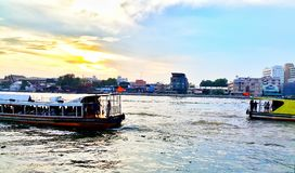 Sunset river view and transportation community Royalty Free Stock Photography