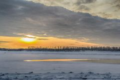 Sunset on the river in winter royalty free stock image