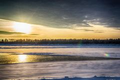 Sunset on the river in winter royalty free stock images