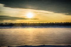 Sunset on the river in winter royalty free stock photos