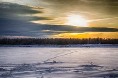Sunset on the river in winter stock images