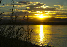 Sunset on the river Royalty Free Stock Photos