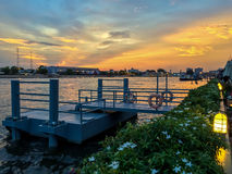 Sunset at a riverside. A beautiful evening by the river in bangkok royalty free stock photos
