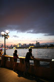 Sunset of riverside. Girl and boy look in the river in the sunset of guangzhou city china Stock Photo