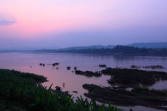 Sunset at riverside of Khong river Stock Photo
