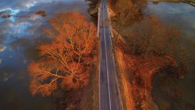Sunset road aerial view flight stock video