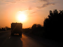 Sunset on the road in Africa Stock Photo