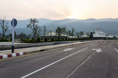 Sunset Road with building and mountain Royalty Free Stock Image