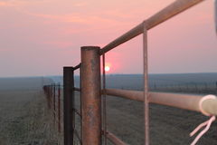 Sunset, Road and fences. Another beautiful sunset on the prairie Stock Images