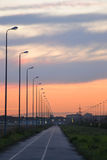 Sunset on the road. Royalty Free Stock Photography