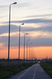 Sunset on the road. Stock Image