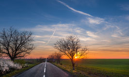 Sunset on the road Royalty Free Stock Image