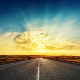 Sunset and road to horizon Royalty Free Stock Photography