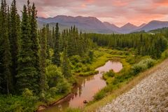 Sunset on the road trip in Yukon territory, Canada. Sunset on the road trip in Yukon territory in Canada, pink and red colors at sunset time, natural beauty royalty free stock photos