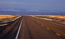 Sunset road in Wyoming. USA Royalty Free Stock Photos