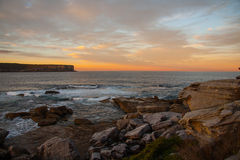 Sunset and rock beach Royalty Free Stock Photo