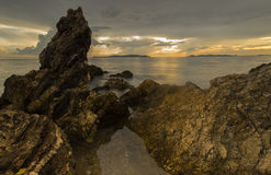 Sunset with Rock at beach Royalty Free Stock Photography