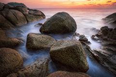 Sunset with rock and beach in Phuket Stock Photos