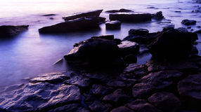 Sunset on rock coast seascape Stock Photo