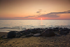 Sunset on the rocks. At the sea Royalty Free Stock Photography