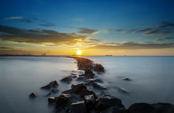 Sunset and the rocks Stock Photography